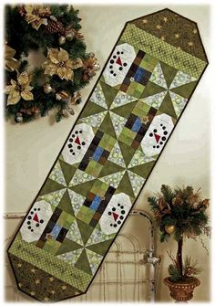 SNOWMEN QUILT RUNNER--enjoy the picture as the link isn't quilt related.