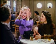 'I just love finding new places to wear diamonds': Lorelei (Marilyn Monroe) tries on a tiara as Dorothy (Jane Russell) looks on.