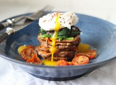 """Veggie and egg """"tower of power"""". Roasted sweet potatoes, spinach, caramelized onions and rich, gooey tomatoes."""