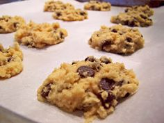 Cookie Monster goes Primal...Coconut Chocolate Chip Cookies    1 cup coconut flour  1/2 cup coconut oil  1/2 cup raw honey (or natural sweetener of choice)  4 omega 3 eggs  1/2 tsp of vanilla extract  1/8 tsp of celtic sea salt  1/2 cup of shredded unsweetened coconut  3/4 cup of 70% dark chocolate chips (or raw cacao nibs)  Parchment Paper (optional)