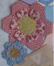 Instructions for the 3-D petals. Adds pizzazz to any Grandmother's Flower Garden quilt. Works with any size Quilt Patis™. $6.00