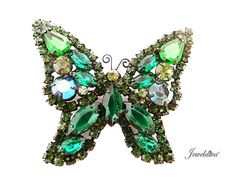 Vintage Signed Weiss Green Rhinestone Butterfly Pin http://www.jeweldiva.com/vintage-signed-weiss-green-rhinestone-butterfly-pin.html