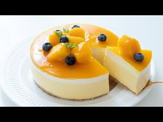 This No Bake Mango Cheesecake is an irresistible dessert with a ladyfinger crust, creamy cheesecake and a mirror glaze on top. It's a refreshing make-ahead dessert bursting with fruity flavor and perfect for a party. See how to make it! Asian Desserts, Sweet Desserts, No Bake Desserts, Sweet Recipes, Mango Mousse Cake, Mango Cheesecake, Mango Pie, Chocolate Cheesecake, Pudding Desserts