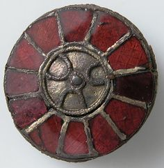 6th century Culture: Frankish Medium: Silver, parcel gilt, foil and wire, glass paste or garnet Dimensions: Overall: 1 1/16 x 3/8 in. (2.7 x 1 cm) Classification: Metalwork-Silver