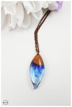 Blue swirled ice drop necklace resin and wood by CutBranchJewelry