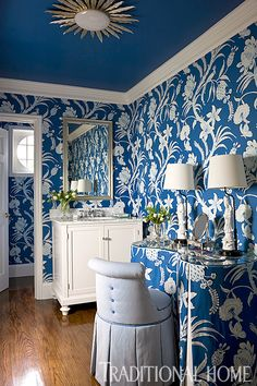 This powder room is a delight in blue and white—from the wallpaper to the trim to the striking blue ceiling. - Photo: Gordon Beall / Design: Kelley Proxmire