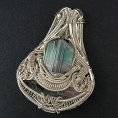 Heady Tourmaline Wire Wrapped Pendant by BlackwolfJewelry on Etsy, $650.00