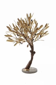Table golden olive tree with curved log | Constantinos Valaes