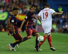 Barcelona's Brazilian forward Neymar (L) and Barcelona's midfielder Sergio Busquets (C) vie with Sevilla's Argentinian midfielder Ever…