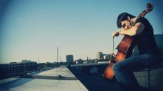Not only does he have awesome hair, but he's really good! Sail - cello cover