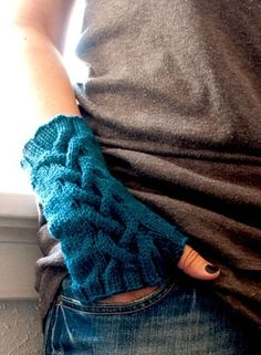 Trilsean Fingerless Mitts from the eBook While They Play by Kalurah Hudson. Shown in Teal Wool of the Andes Worsted.
