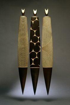 Stephan Goetschius celebrates the warmth and directness of wood.  Various Figures burnt maple, 30 x 4.5 x 1.5 (each)