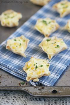 Cheesy Corn Bites - cream cheese, egg, pepperjack, and corn in scoop-shaped tortilla chips, baked and then garnished with cilantro.
