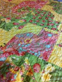I love the cat quilt with snail tails
