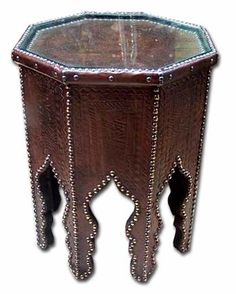 I'm looking for a side table with this shape but not leather like this one...anyone have any ideas?