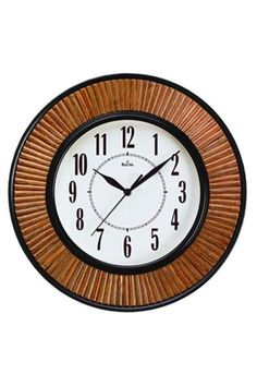 "BULOVA HAWORTH WALL CLOCK, C4641  HAWORTH: This clock comes with a molded case in chocolate brown finish. Individually cut and set rattan inserts. It has a Protective glass lens. Dia.: 14"" D: 2.25"""