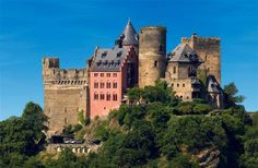 Castle Auf Schönburg (In Germany)has a library, a romantic restaurant by candle light, and two terraces looking out onto vineyard-covered hills. One of their best hotel rooms is the tower room; its wooden balcony sits high up above the Rhine, like a bird's nest on the castle's stone tower.