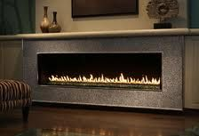 linear gas fireplace - low with TV above and shelves on side
