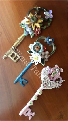 Something different... Custom order: Vintage keys and plain white frame, delicately painted and decorated with quilled flowers. Handmade by Eliane Tanassi ♧ The Quilling Fairies ♧, first quilling artists in Lebanon!