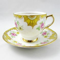 Pretty yellow tea cup features small pink roses on the teacup and saucer. Gold trimming along the edges of the tea cup and saucer. Excellent condition (see photos). Markings read: Salisbury Bone China Made in England Please bear in mind that these are vintage items and there may be