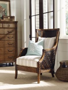 Tropical accent chair with coral print throw pillow from Tommy Bahama Home | Lexington Home Brands Furniture