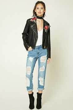 A pair of boyfriend jeans featuring a distressed design, a low-rise, a buttoned zip fly, and a five-pocket construction.