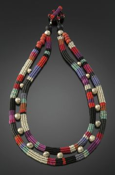 Julie Powell – Silver, Red, and Jewel Tones Echo Necklace