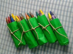 Favors Idea: 6 wax crayons, washable of course, wrapped in a simple green tissue paper and tied with string