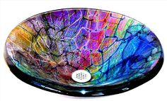 Dichroic vessel sink - amazing and has got to be expensive!! That sheet of dichro alone is $210...