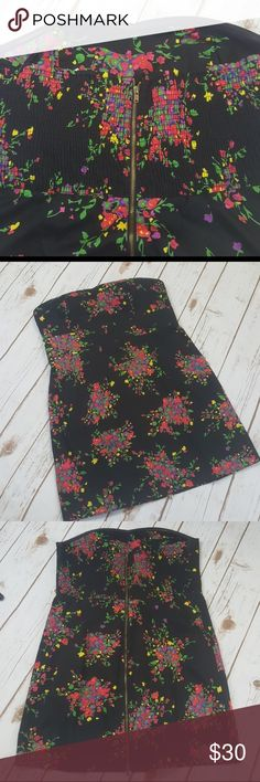 Free people strapless mini dress Like new condition. Color black. Floral print. Red, yellow, green. Elastic upper back. So there is give and stretch. Zipper intact. Zips all the way down to the bottom, in the back.  Summer festival date night birthday party anniversary party vacation cruise beach lounging pool bikini cover up top. Wedding, wedding shower. If you like my items please share and follow for my new listings. Free People Dresses Strapless