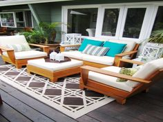 Outdoor living rooms need not be opulent. Sturdy upholstered seating, an ottoman that doubles as a coffee table, side tables and a rug might be all you need to create a cozy, cohesive space. Patio Rugs, Patio Chairs, Outdoor Chairs, Outdoor Decor, Outdoor Living Rooms, Rugs In Living Room, Outdoor Spaces, Living Spaces, Cozy Living