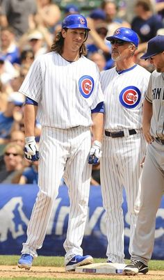 Jeff Samardzija stands on first after singling in Darwin Barney with the go ahead run in the sixth. 5/29/12