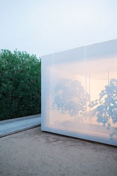 Personal home by Atherton Keener    The facade shifts between being opaque and semitransparent.