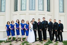 Jamie Tervort photography. Bridesmaids dresses from Diviine Modestee. Groomsmen in black suits with black shirts and royal blue ties. Bride's dress from Fantasy Bridal. Groom's tux from Men's Wearhouse.