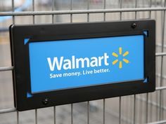Wal-Mart shares drop as company predicts lower profits