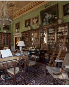 library at Hatchlands Park, 1750s National Trust English country house, including part of historic keyboard instrument collection, in East Clandon, Surrey, UK