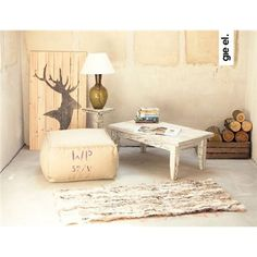 The perfect supplement to your industrial living room, this linen pouffe features a rustic design and stenciled detailing. Match with a worn leather chesterfield and beaten brass accents to complete the look. Glass Table Lamp, Decor, Leather Rug, Table, Furniture, Pouffe, Handwoven Rugs, Industrial Bedroom Diy, Coffee Table