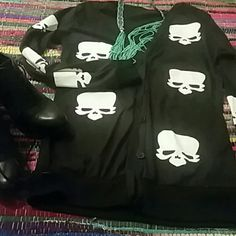Skull Cardigan. Buttons down the front. Don't have a tag on it but fits like a Small. In good condition. Sweaters Cardigans