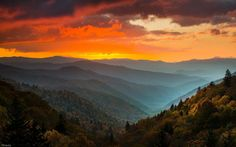Oconaluftee Overlook offers an unparalleled mountain view and is a magical place to welcome a new day! #SunriseSunday (Photo: Tom S. Haxby)