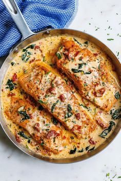 fish recipes Creamy Garlic Tuscan Salmon With Spinach and Sun-Dried Tomatoes - - Smothered in a luscious garlic butter spinach and sun-dried tomato cream sauce, this Tuscan salmon recipe is so easy, quick, and simple. Baked Salmon Recipes, Fish Recipes, Seafood Recipes, Dinner Recipes, Cooking Recipes, Healthy Recipes, Salmon Spinach Recipes, Delicious Recipes, Cake Recipes