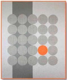Grey and Orange circle quilt.