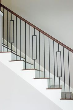 Contemporary Stair Balusters This Staircase Uses High Quality Wrought Iron Baers To Create Unique Style Design Modern Metal Stairway Photos - Concrete Baer Designs Home Decor Modern Wood Recommended Modern Stair Railing, Wrought Iron Stair Railing, Stair Railing Design, Staircase Railings, Iron Balusters, Staircase Remodel, Modern Stairs, Stairways, Bannister