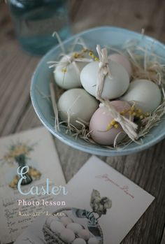 I like the way the eggs are tied up with a sprig of flower and nestled in the robin's egg blue bowl Hoppy Easter, Easter Bunny, Easter Eggs, Easter Table Decorations, Easter Decor, Easter Festival, About Easter, Easter Parade, Easter Celebration