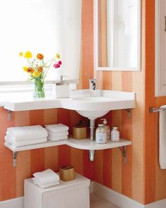 This is a very clever and modern solution to the corner problem. It adds a little counter space, often needed in a small bath.