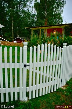 White picket fence with gate.