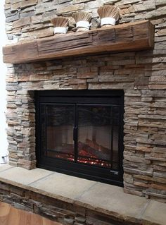 These one of a kind reclaimed wood mantels are treated and stained and will be a beautiful addition to your fireplace when surrounded by stone. Description from stoneselex.com. I searched for this on bing.com/images