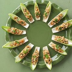 Endive Chicken Boats-- chicken, peanut sauce, lime juice, cilantro are ingredients. Easy and got lots of compliments!