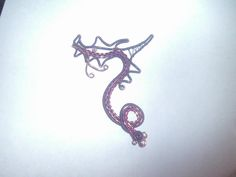 Wire wrapped Violet and Purple Chinese Dragon pendant.