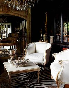 Love the gold and white chairs.