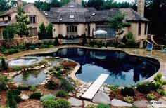 Black dye added to the plaster gives this pool a dramatic finishing touch, and the dark color can help warm your pool in summer.